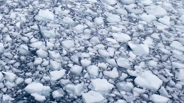 melting ice on lake